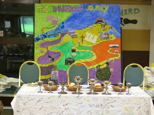 The children's dangerous journey, the table set for Communion & the tablecloth with our embroidered names
