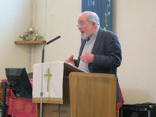 Revd.Jim Corrigall addresses the meeting